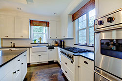 black granite white cabinets Granite kitchen - Denver Metro Stone City LLC